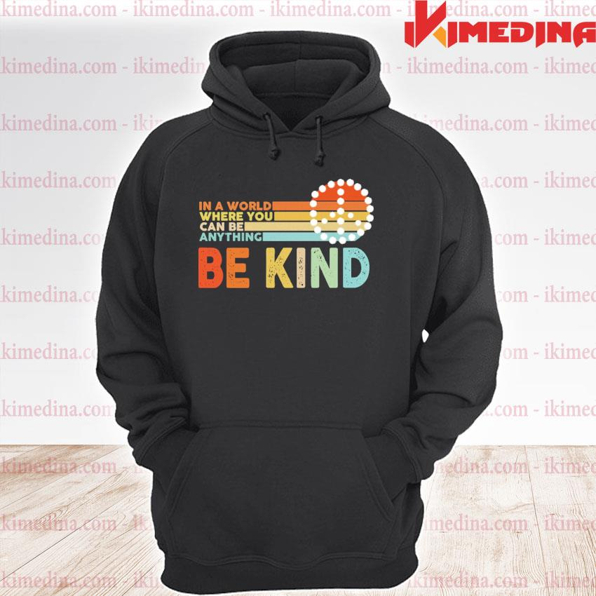 Official in a world where you can be anything be kind s premium hoodie